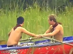 Lewd lads rowing in a boat and grinding on the beach