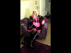 Chrissie smoking a 120 in a sensual pvc maids dress
