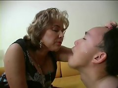 Dominant French female spits in her slaves mouth