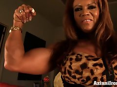Muscle chick pumps up her big clit