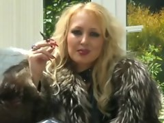 Blond Mistress In Fur Smokes