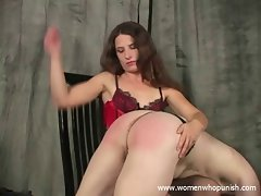 Leda spanks her slutty slave with her hands and paddle