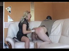 Femdom foot fisting and deep strap-on on slave