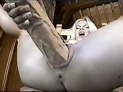 Blondie Whore shoves a big toy up her pussy