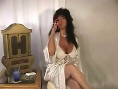 Top heavy Mommy In Satin Smoking & Licking