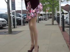 Attractive Mummy Lets the Wind Blow Her Skirt Up