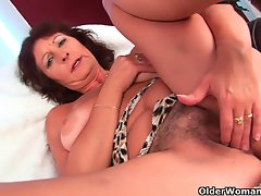 Big titted senior lady rubs her shaggy pussy with her fingers