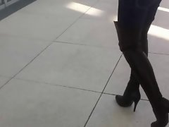female trying Thigh High Boots in public