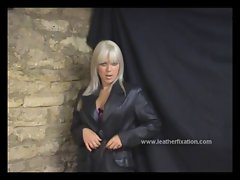 Alluring young lady talks obscene and masturbates on leather coat