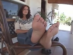 Attractive mom with cheesy feet