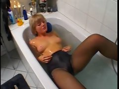 Stunning Blond Using Glass Fake penis And Putting On Black Pantyhose
