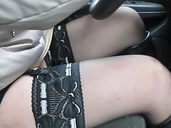 Girl flashing stockings tops in car while driving