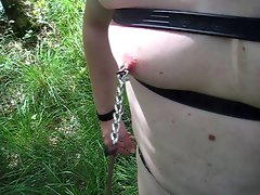 nipple torture with sharp clamps in the woods