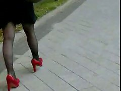 Candid #65 Wench with sexual legs in sweet red high heels
