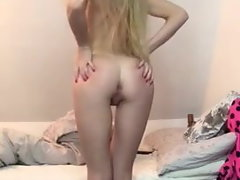 thin blond strips out of her ebony sundress