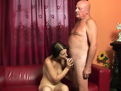 Old man penetrates on red sofa young brunette with natural tits