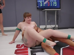 Two buxom ladies are in the middle of lesbian wrestling