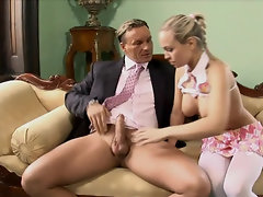 Blonde wife is sucking off a cock while the cuckold is watching
