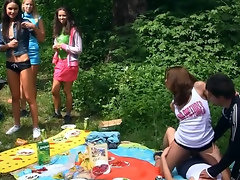 Naughty babes merge bodies and start touching pussies at picnic