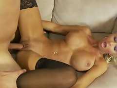 Blonde cougar has an amazing pair of tits and she loves young boys