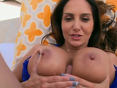 Brunette is using her massive breasts to her advantage