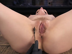 Young blonde babe gets tortured with a pinwheel