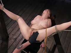 Busty redhead slave girl gets tortured by her master