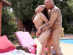 Lustful babe is banging her bald lover near the swimming pool