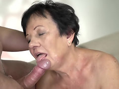 Short-haired old woman tastes young cock once again