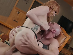 Tattooed redhead Lauren Phillips rides big cock in the cabin