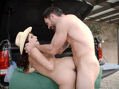 Cowgirl with long curly hair gets fucked by a horny farmer