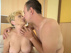Granny with some saggy tits is having her old fat body fucked hard
