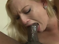 A blonde is with a black guy that has a large dick, having interracial sex