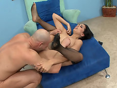 A chick that has large tits is getting fucked by a bald dude